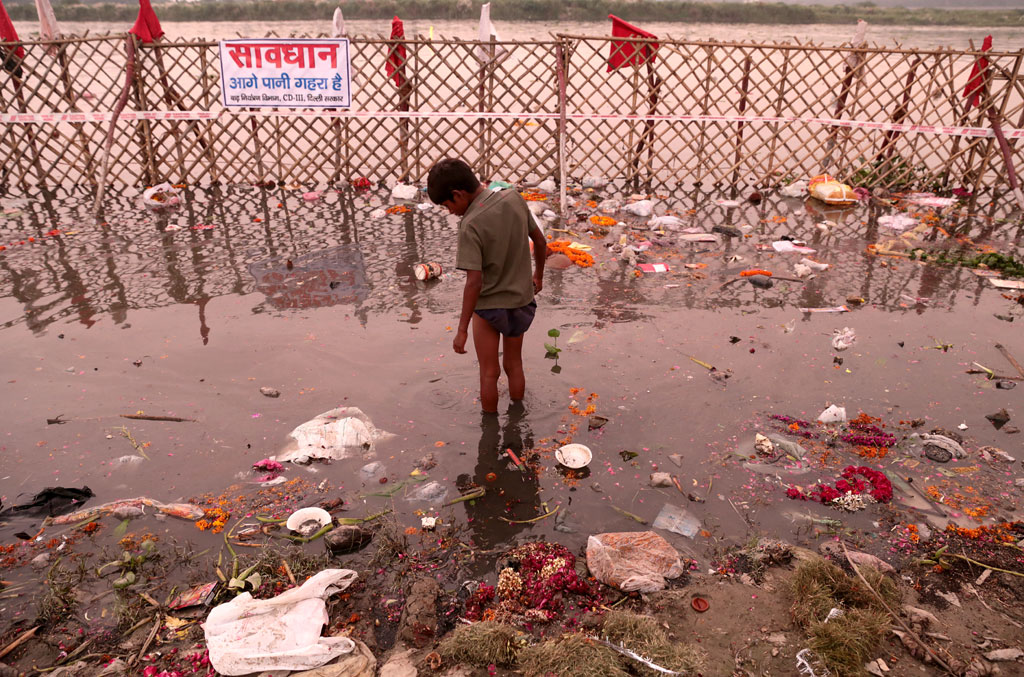 The National Green Tribunal has recently ordered that only naturally-made idols can be immersed in water bodies such as rivers. But it is another matter that nobody follows the rules. And all sorts of idols find their way into River Yamuna in Delhi.