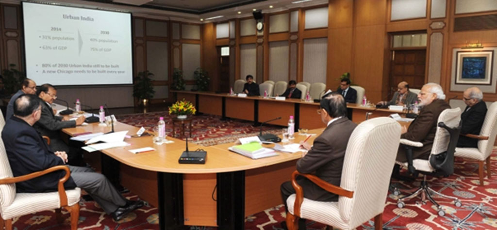 Prime Minister Narendra Modi chairing a high-level meeting with government officials on the SmartCity initiative in December 2014 (Source: Wikimedia Commons)