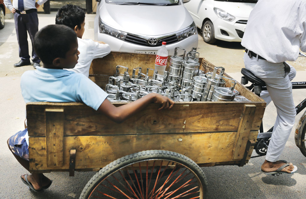 Some tiffin services in Delhi deliver food to