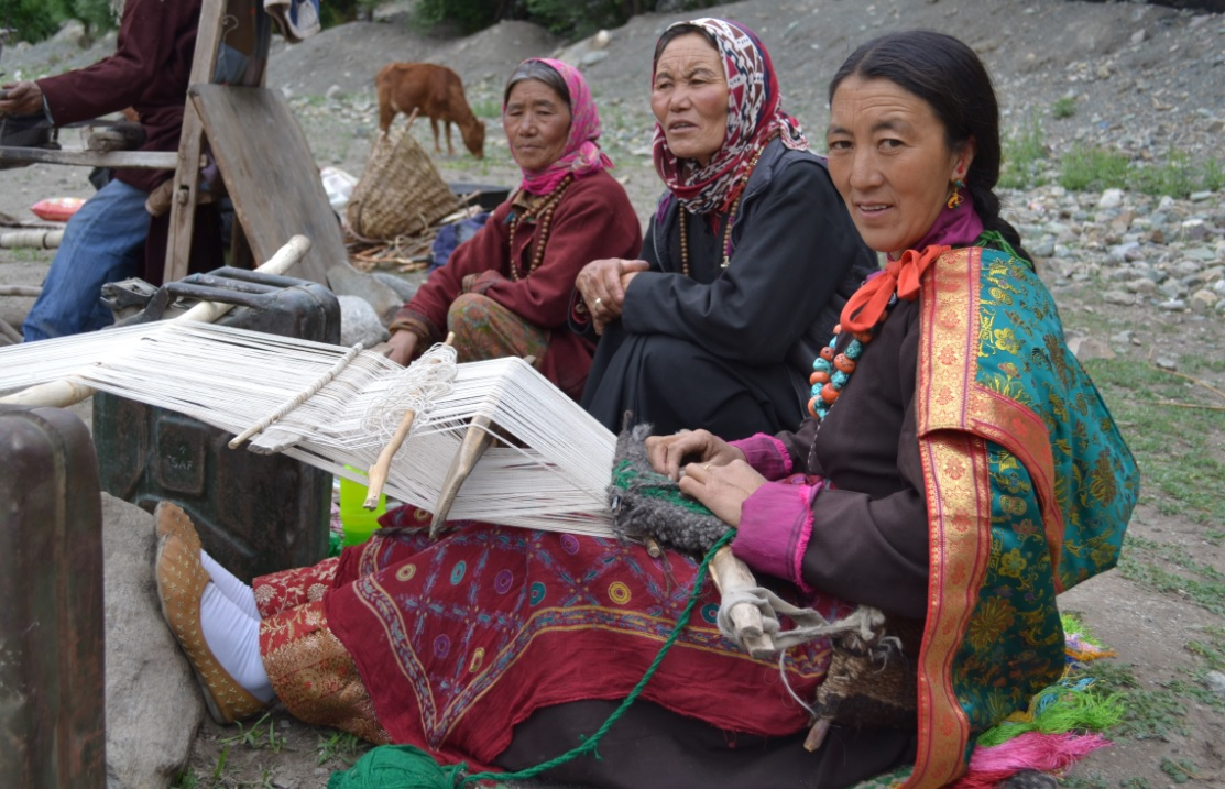 A group of women spinning their weaving yarns during the gathering they organised as hosts  (Photo: Lead India)