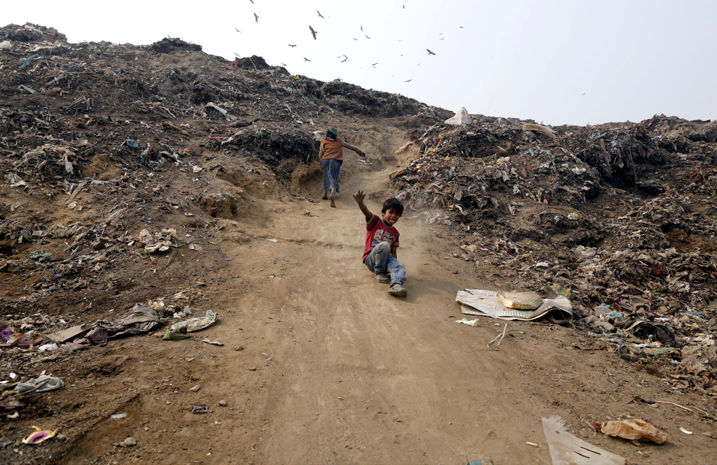 Child ragpickers often catch infections as they rummage through the garbage with bare hands.