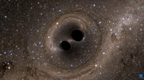 Seen here are two black holes before their merger into one Credit:The SXS (Simulating eXtreme Spacetimes) Project