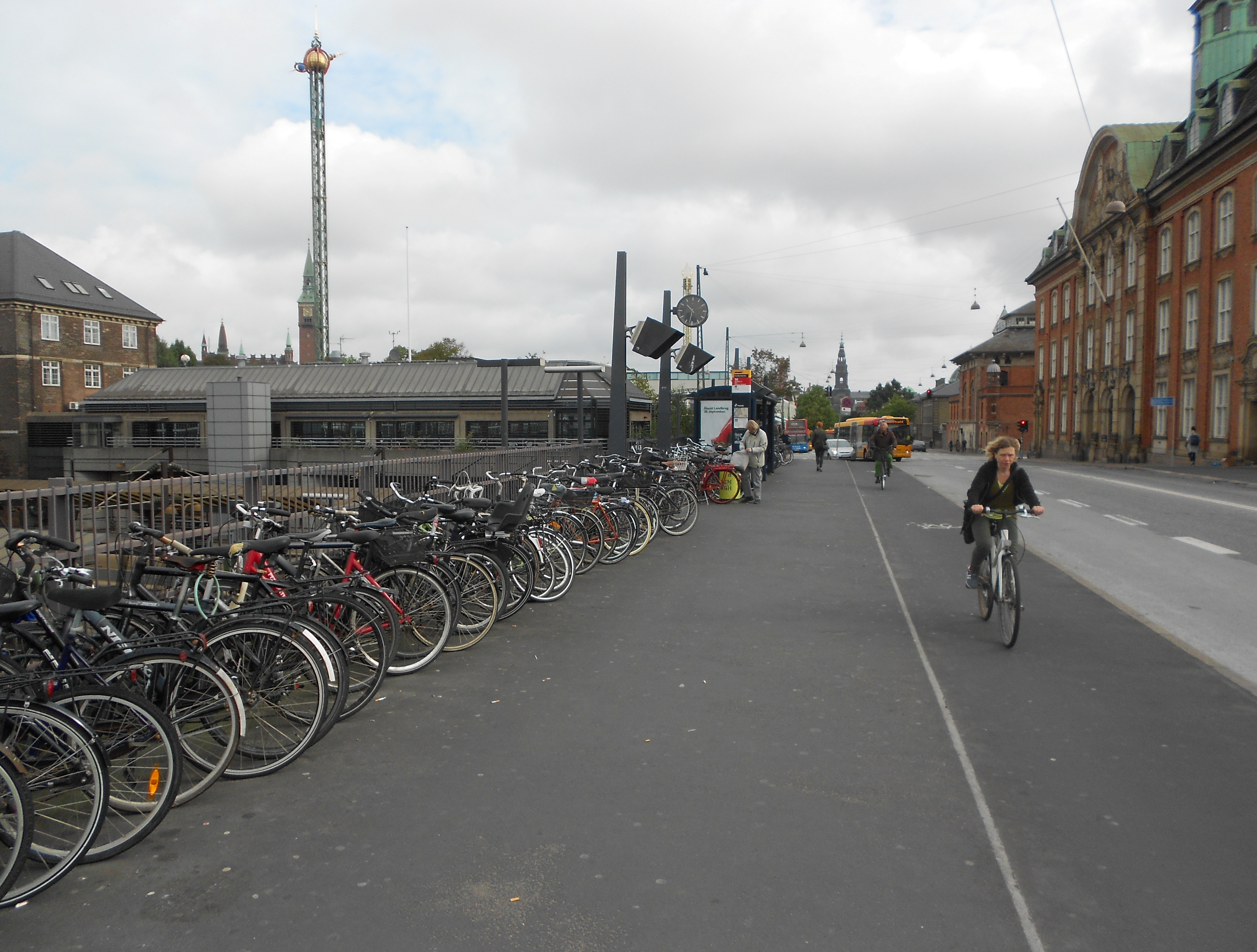Bicycles parked outside a train station and separate bike lanes in Copenhagen      Credit: Emmanuel D'Silva