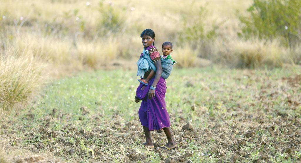 A Baiga woman in Rajni Sarai crosses the area from where people collect mushroom (Photographs: Vikas Choudhary)