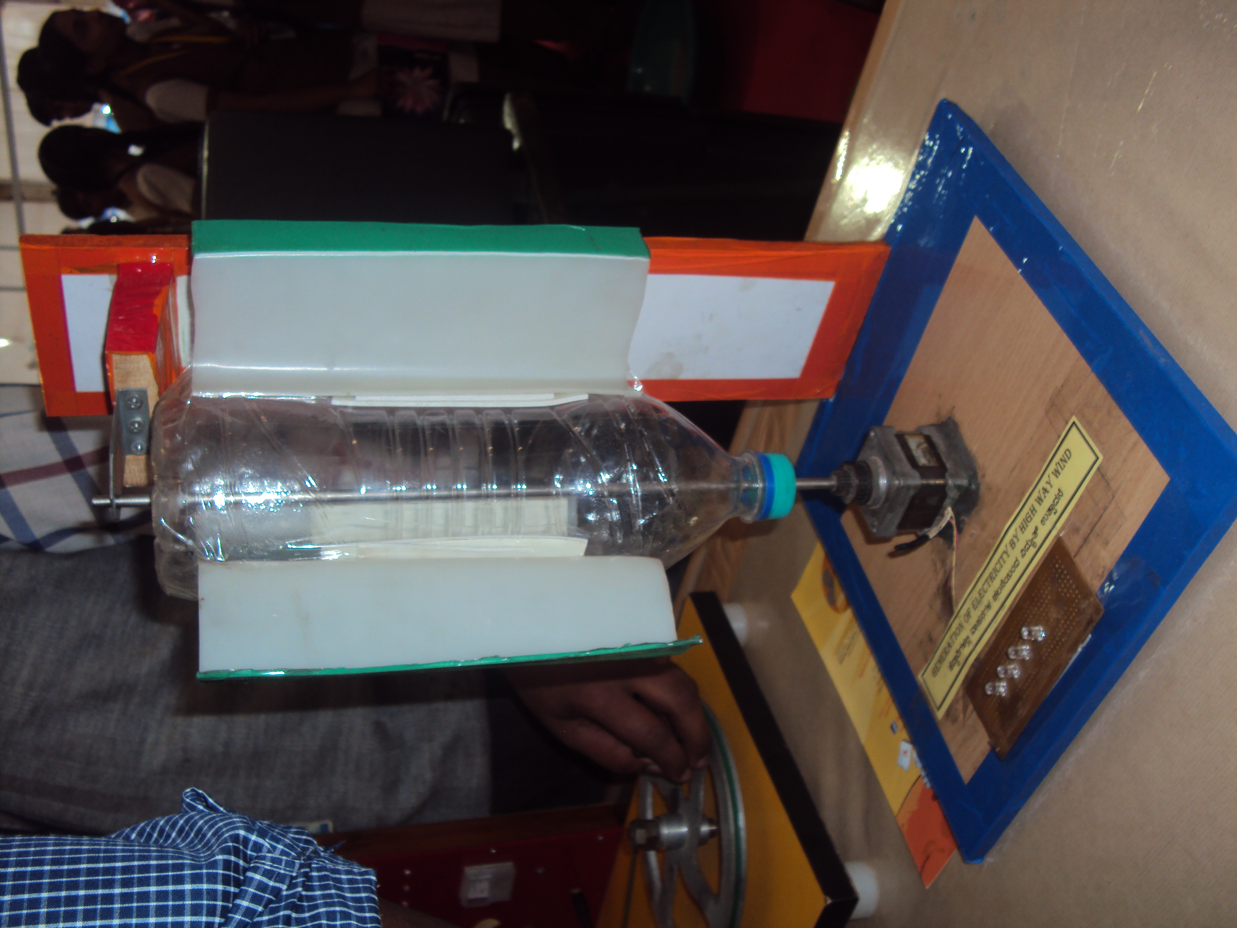 In this electricity generator, wind rotates the poles (bottle), generating mechanical energy that can be converted to electrical energy. This electrical energy is responsible for the lighting of the bulb.