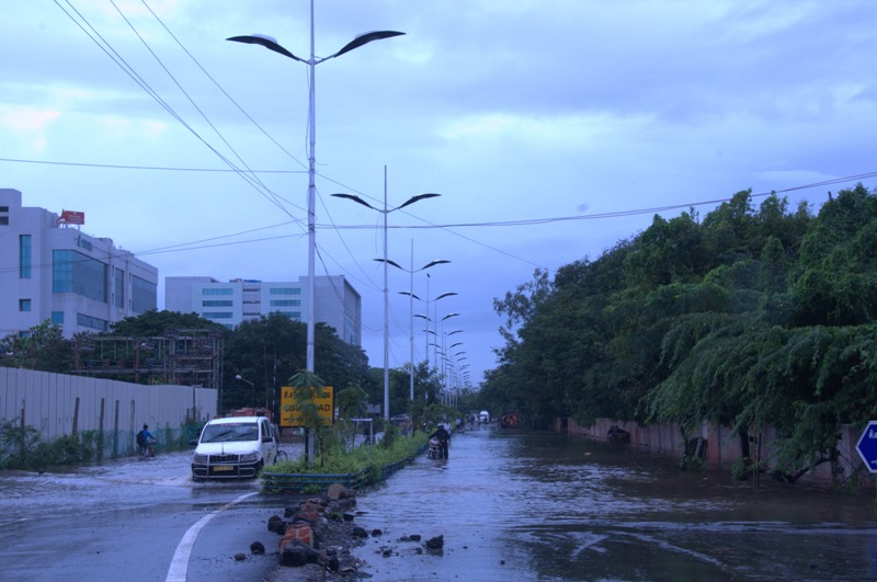 Roads remain inundated in many parts of the city. In many areas, they have also caved in (Photo: Shreeshan Venkatesh)