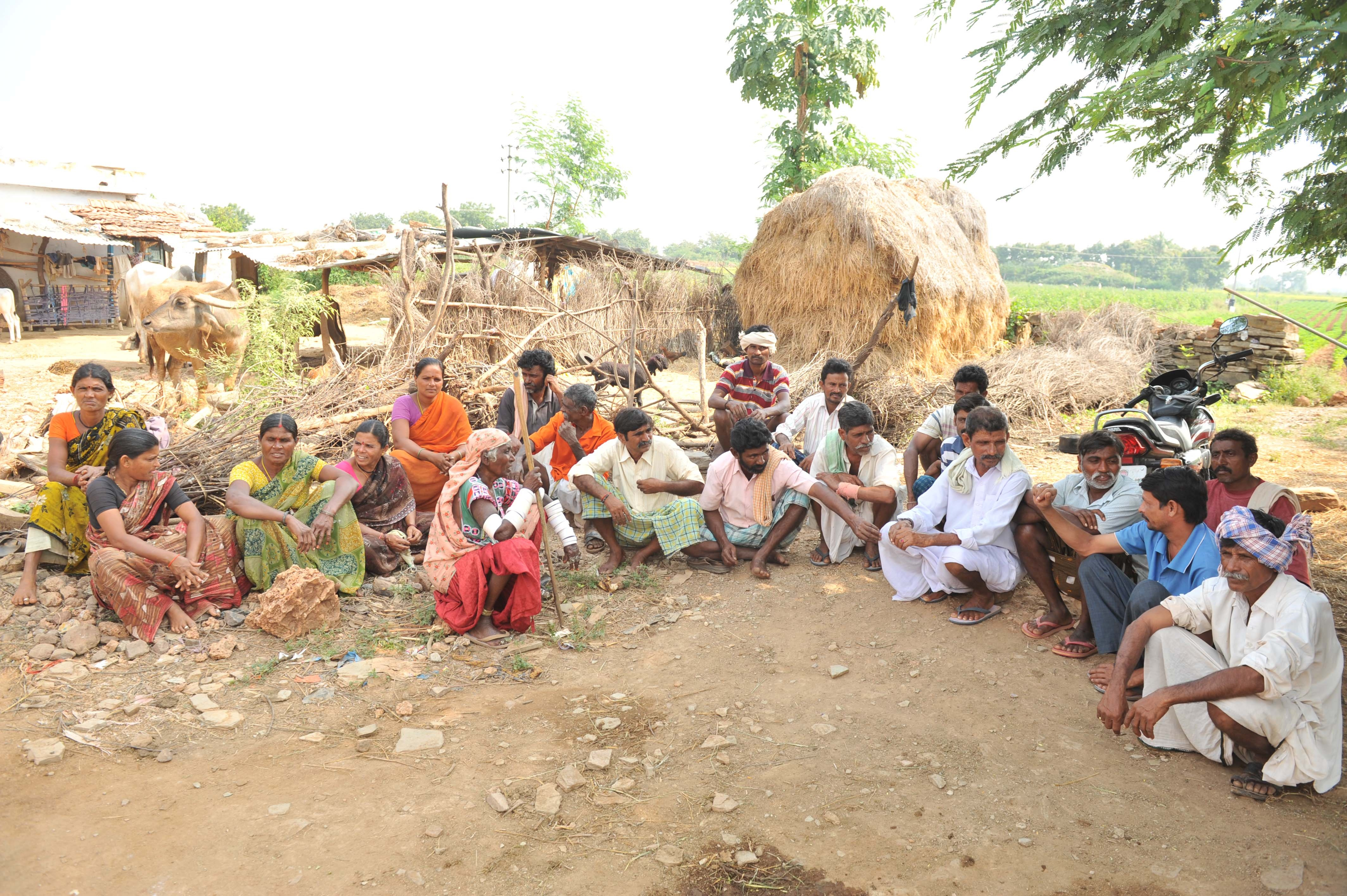 Social protection schemes can help the vulnerable in local networks. Here, villagers in India discuss how to monitor groundwater levels