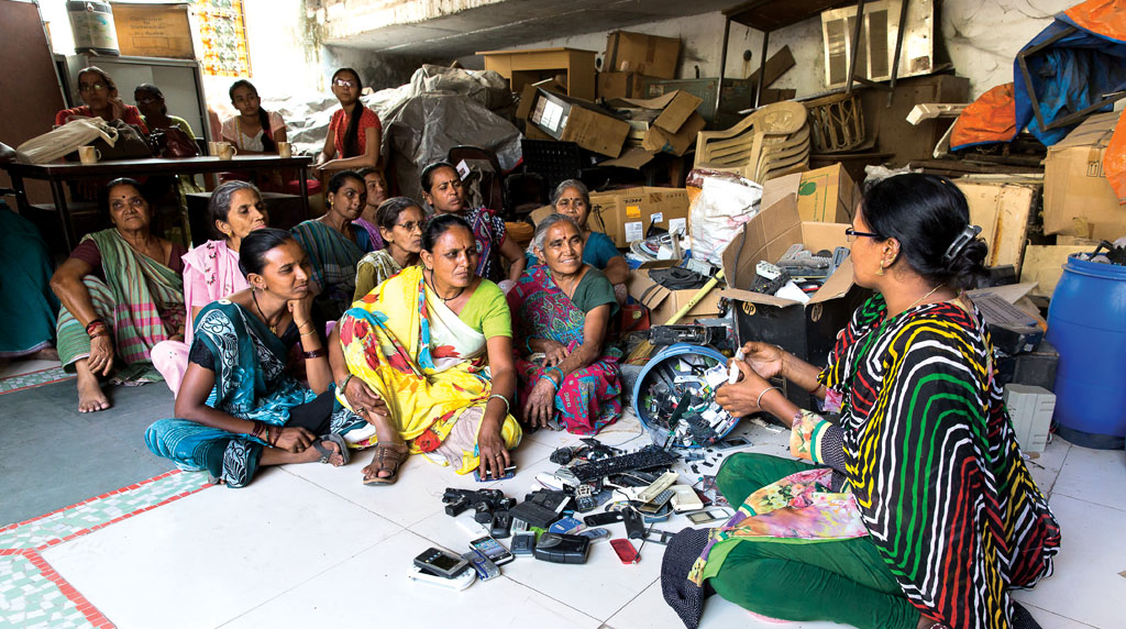 Women ragpickers gather for a training session in Ahmedabad (Photo: GIZ/VOSTRY)