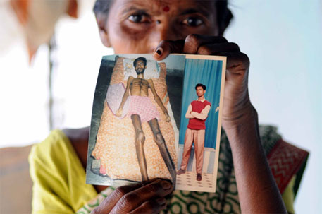Sadhana Das holds up photographs of her son Sasthi who died of silicosis in 2006. He was only 25 (Down To Earth)